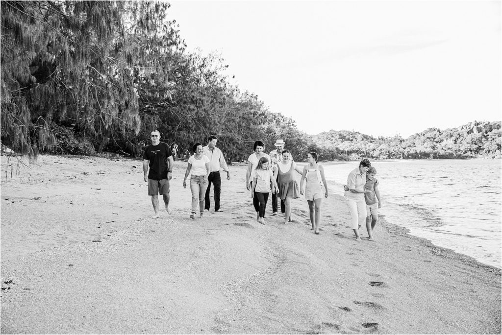Large family walking on beach on Magnetic Island.