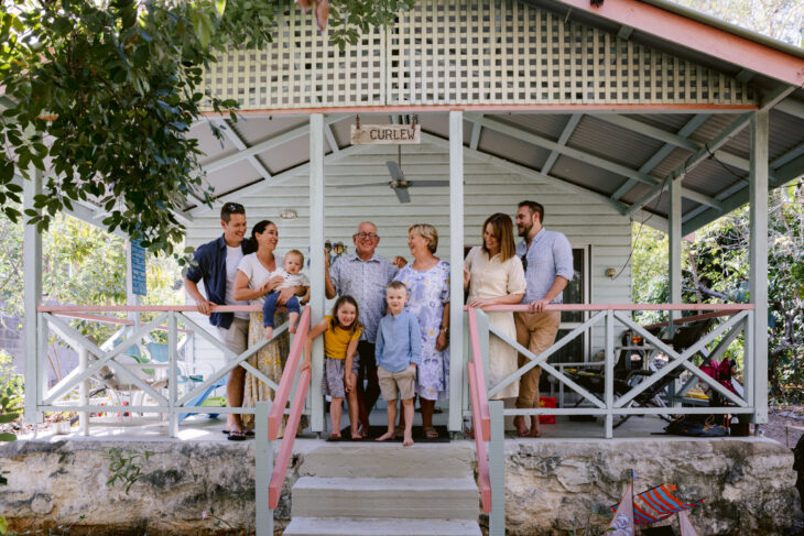 Three Generations of family gather on the front porch of the Magnetic Island holiday house.