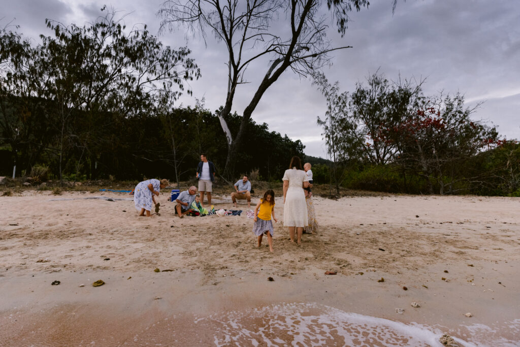 All the family enjoy a picnic at the beach late in the afternoon at Geoffrey Bay Magnetic Island.