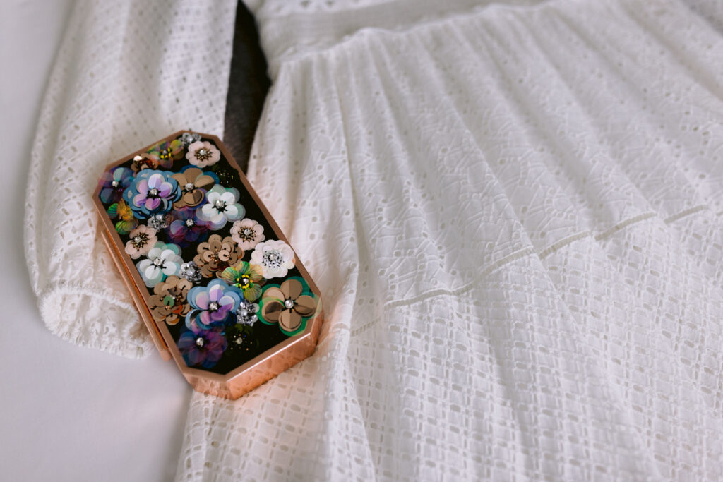 Hannah's elopement dress and her beaded clutch purse.