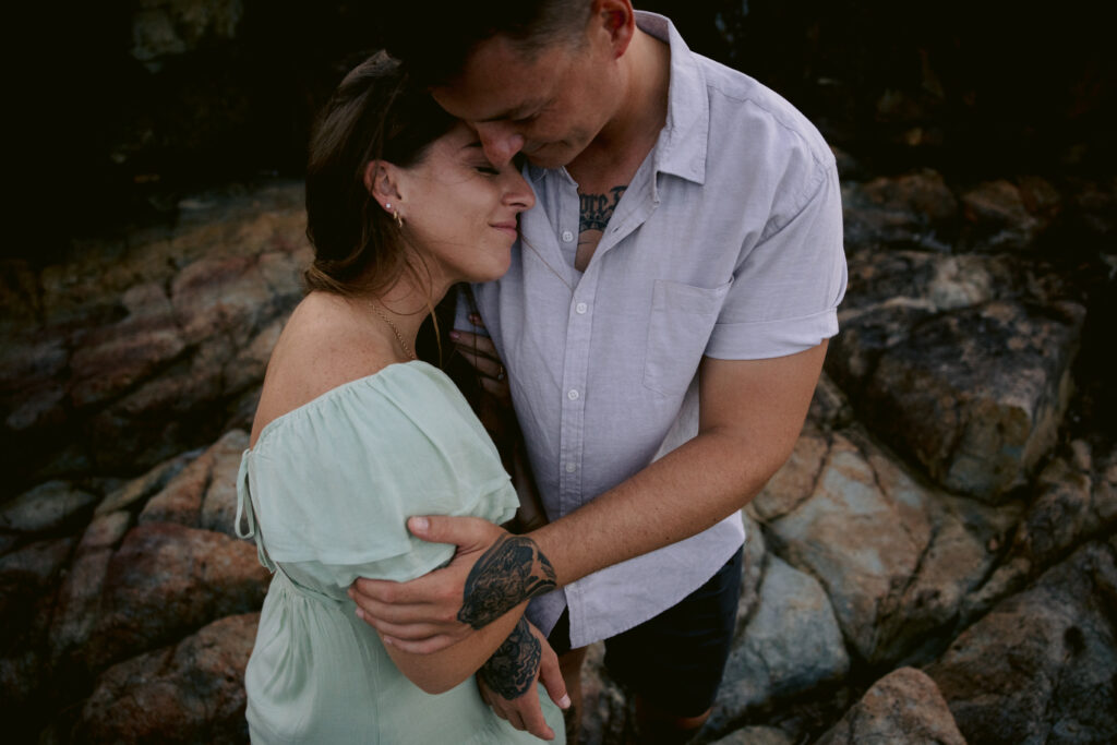the couple lovingly embrace for their engagement photo shoot