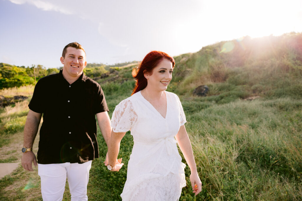 Jess leads Billy as they walk along a path with a grassy hill beside them.