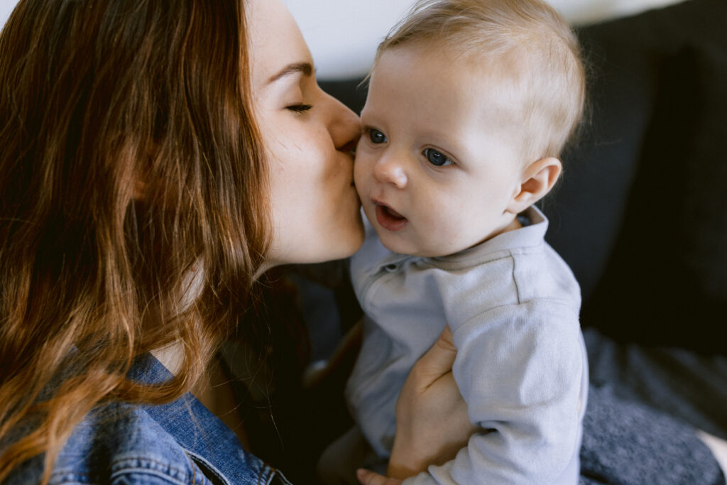 Casey kisses Harvey's cheek.