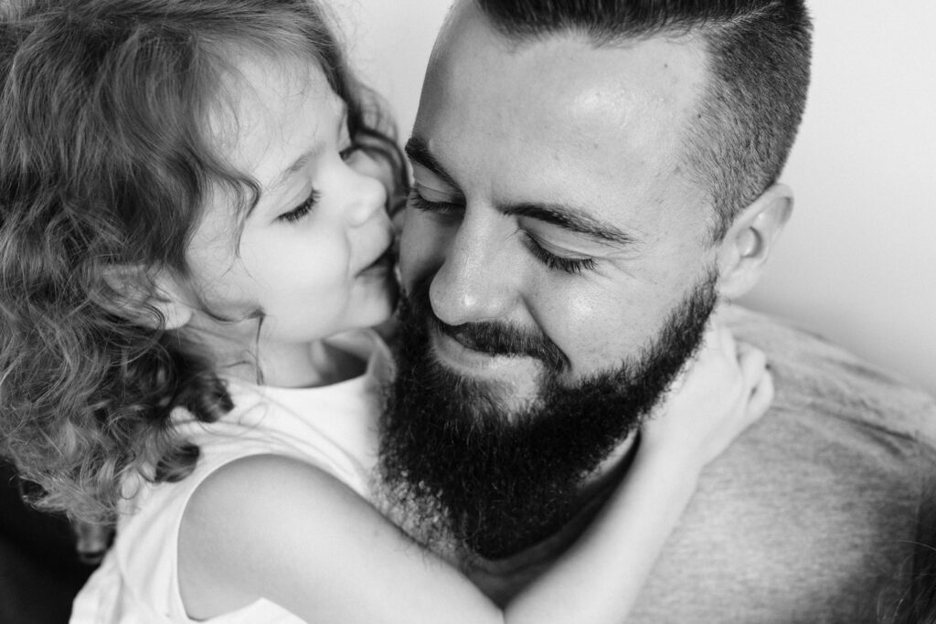 Pip goes to kiss her Daddy's cheek