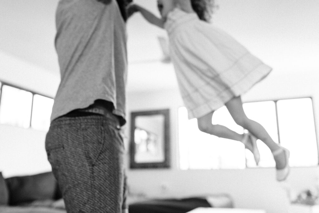 Pip and her Daddy dance in the lounge room